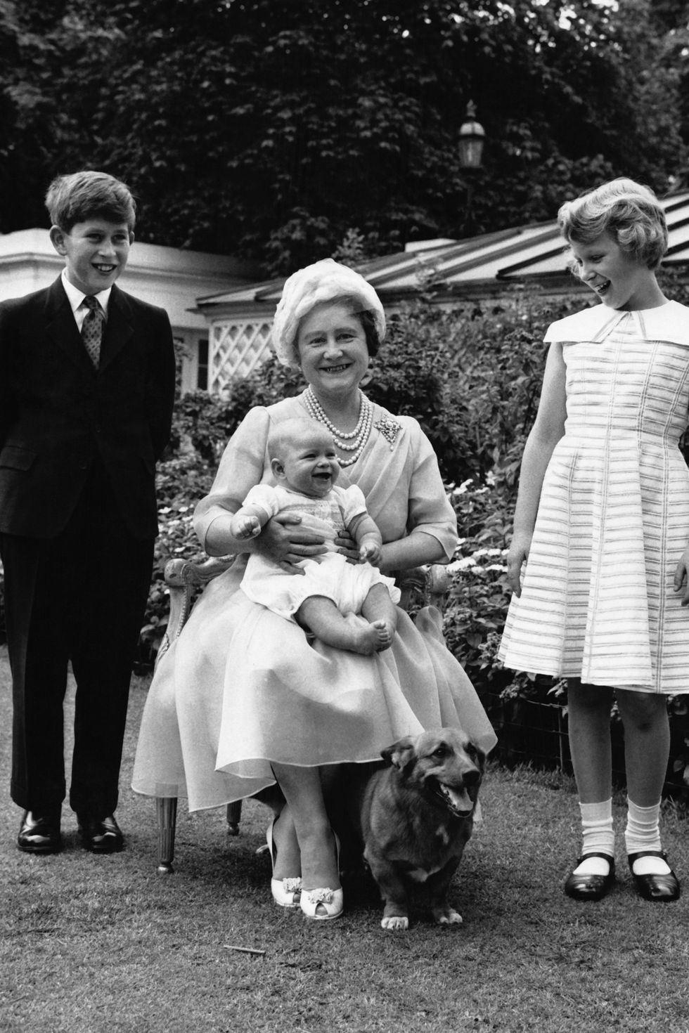 Queen Elizabeth with her grandchildren Prince Charles