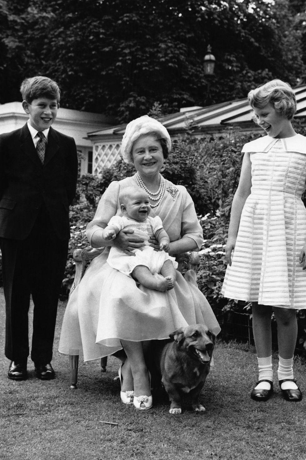 Queen Elizabeth with her grandchildren Prince Charles