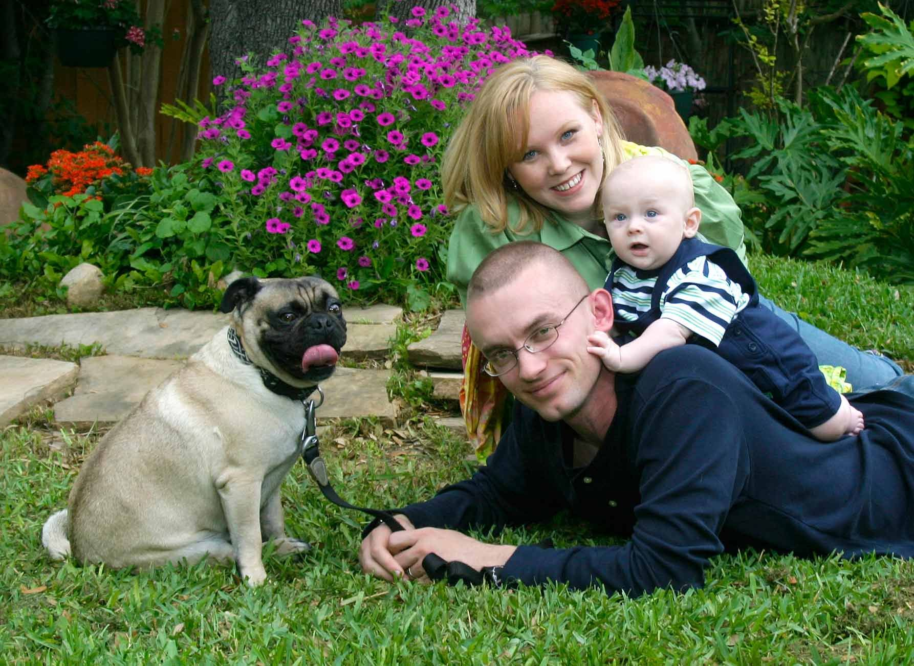 Family Portraits With Dad Mom Baby And Their Pet Dog Pets Can Make An Interesting Addition To A Photography Session
