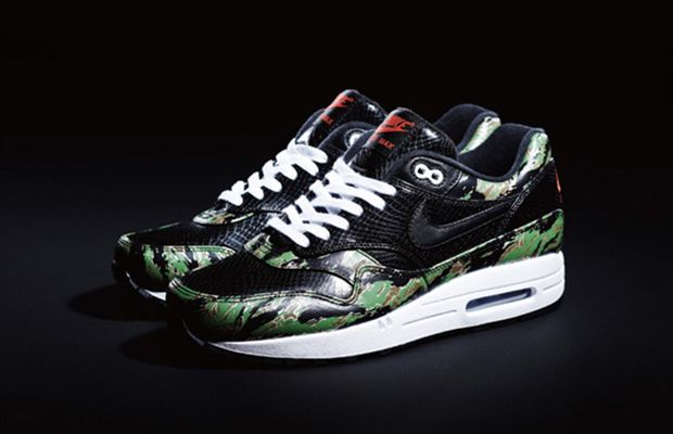 The Animal Camo Pack consists of a men's Air Max 1 featuring a black  python/green camouflage upper and a women's Air Max featuring a leopard  pattern/desert ...