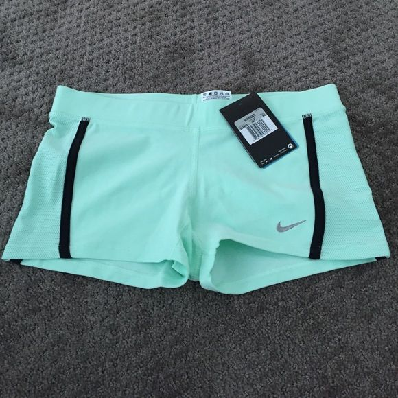 Nike XS mint colored shorts NWT Nike XS tight fitting mint colored shorts.  New with tags!!  Great for your summer workouts!! Nike Shorts
