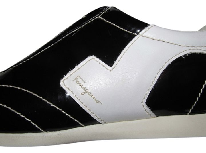 Salvatore Ferragamo Sneakers Size 7 BLACK/WHITE Athletic Shoes. Get the must-have athletic shoes of this season! These Salvatore Ferragamo Sneakers Size 7 BLACK/WHITE Athletic Shoes are a top 10 member favorite on Tradesy. Save on yours before they're sold out!
