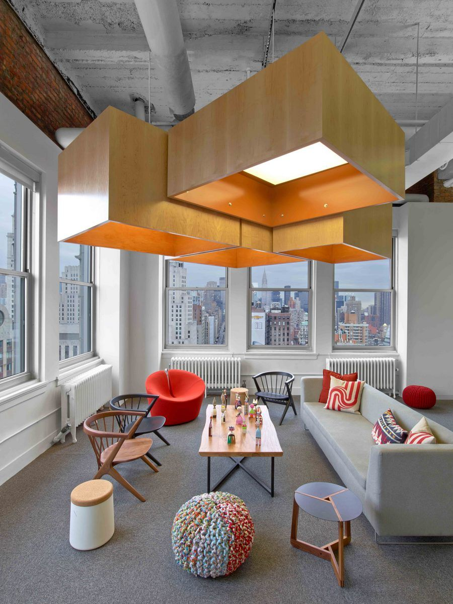 Use of accent color and different textures to make the for Interior design office new york