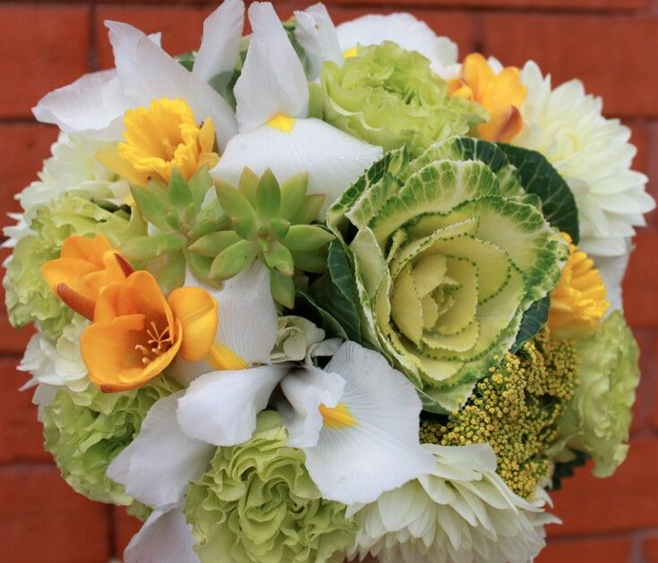 Pretty Wedding Bouquet Arranged With: White Chrysanthemums, White/Yellow Iris, Yellow Daffodils, Yellow Freesia, Green Roses, Green Kale, Green Succulents, Yellow Riceflower