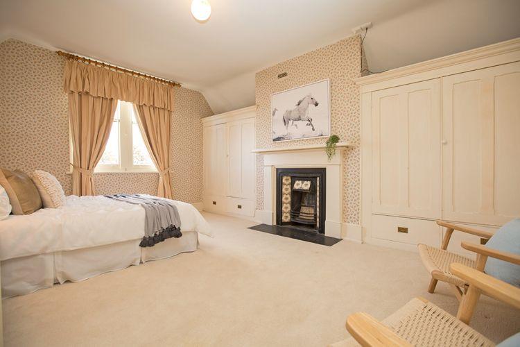 guest bedroom, floral wallpaper, gold curtains, horse artwork