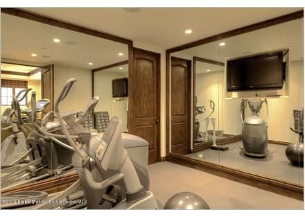 The flat screen tv in this home gym helps take the edge off of