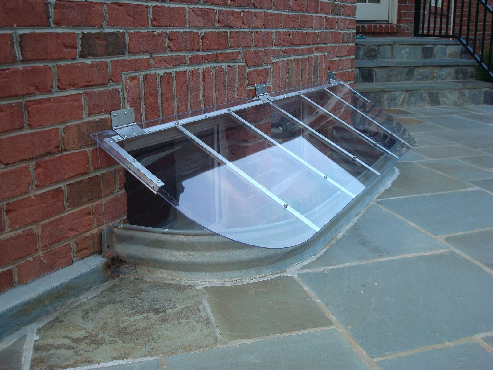 brick basement window wells. Slanted Window Well Cover To Repel Rain, Snow And DebrisMade Brick Basement Wells