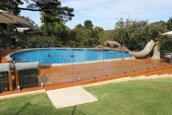 Pool design holz  above ground pools with decks wooden deck glass banister garden pool ...