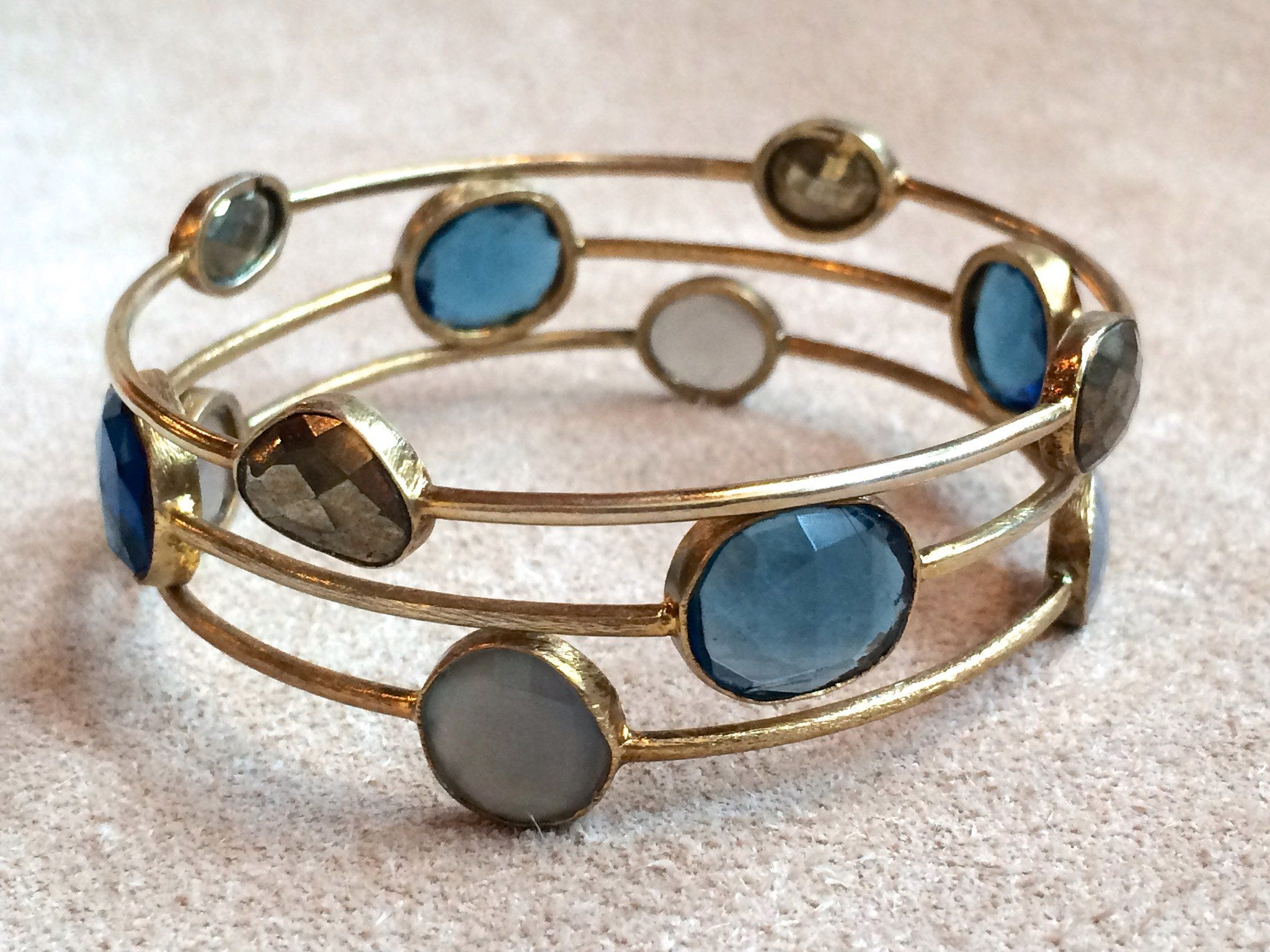 Great alone or stacked these gemstone bangles measure 25
