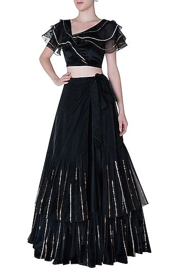 b3191162c0 PINK PEACOCK COUTURE Featuring a black lehenga skirt in velvet base with 3D  rose gold handwork embroidery and tie up. It is paired with a matching  ruffled ...