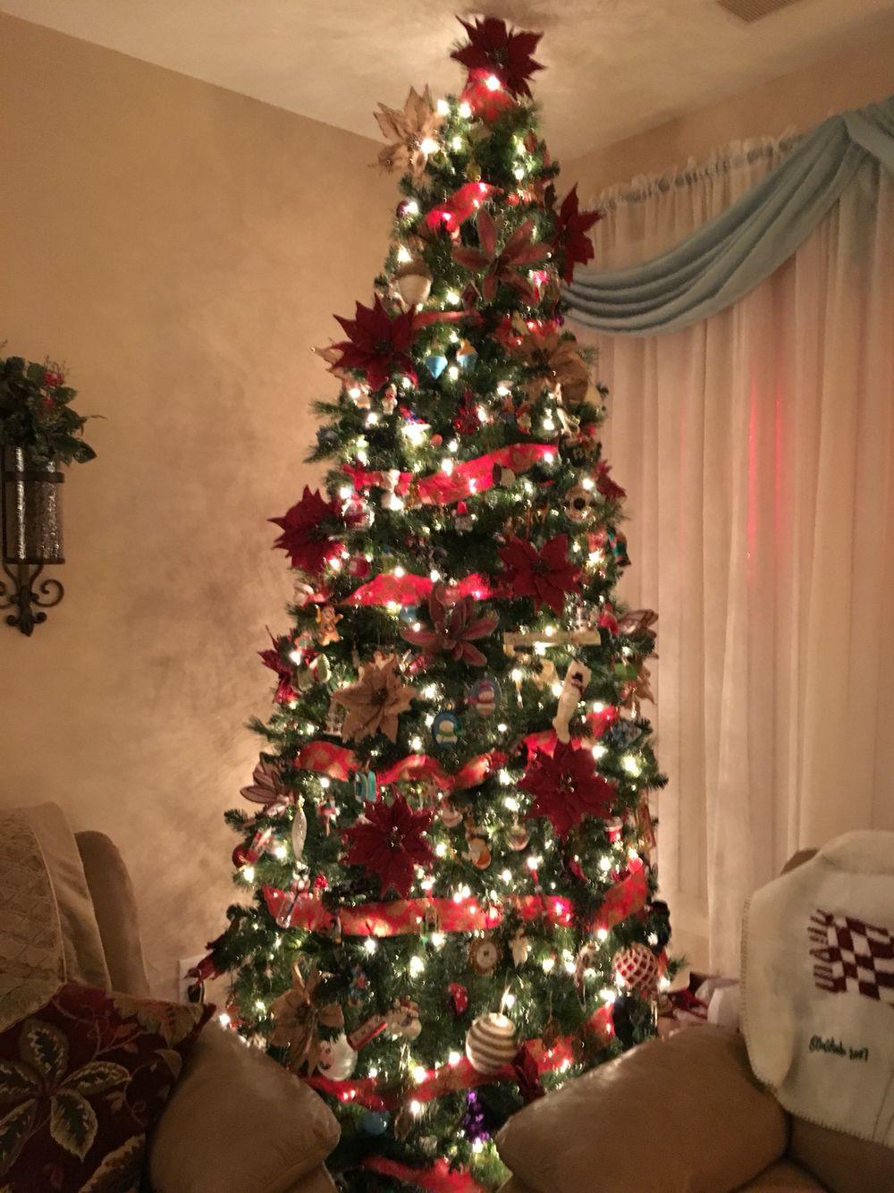 2015 main christmas tree with burlap ribbon and poinsettias - Burlap Ribbon Christmas Decor