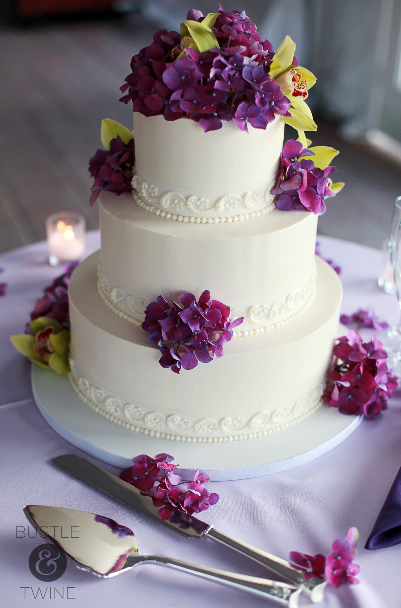 Purple Flowers On A White Cake Photo By Bustle Twine