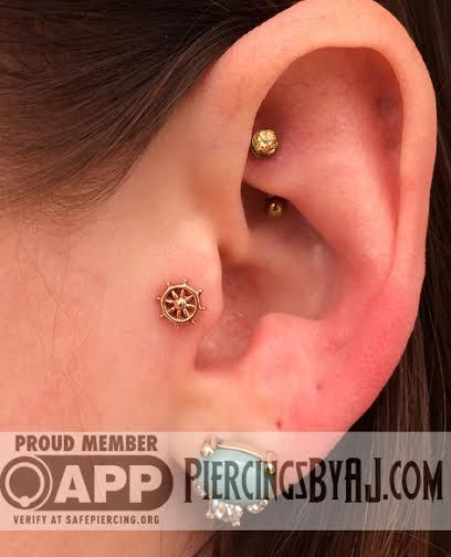 Fresh tragus piercing featuring a 14k rose gold Sol Flower and