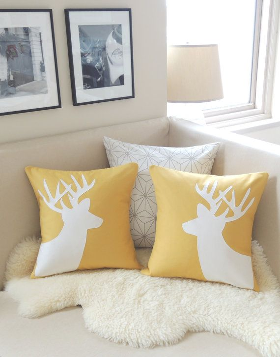 This deer pillow cover pair adds a chic woodland layer and punches up your interior space in mustard yellow and ivory--perfect for the holidays!