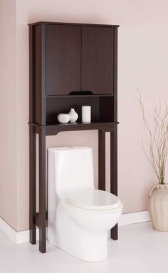 over toilet cabinet space saver is a wood veneer cabinet that fits over standard sized toilets providing convenient storage in your bath - Bathroom Cabinets That Fit Over The Toilet