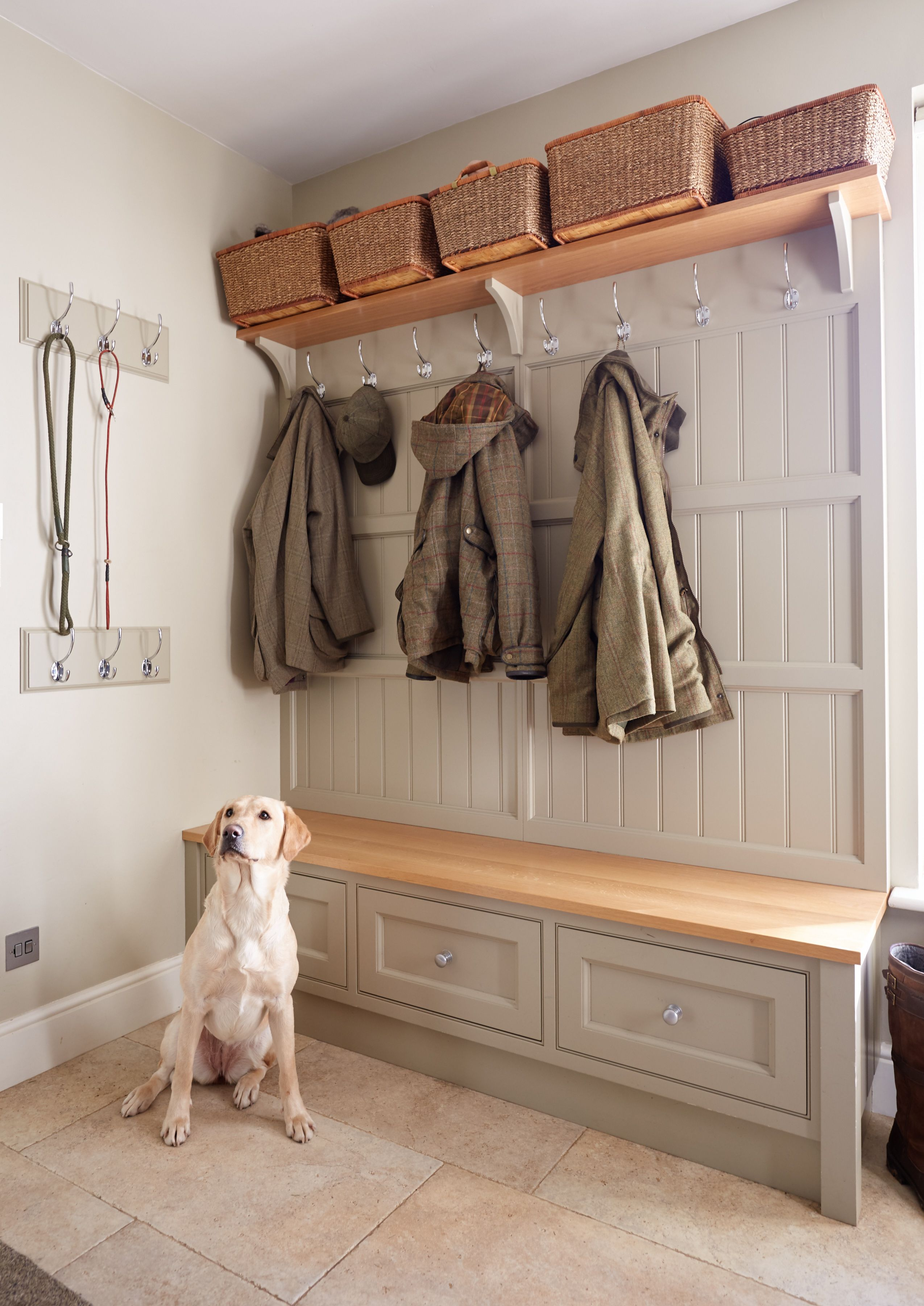 Hallway storage with hooks  Bespoke boot room with various storage solutions with coat hooks