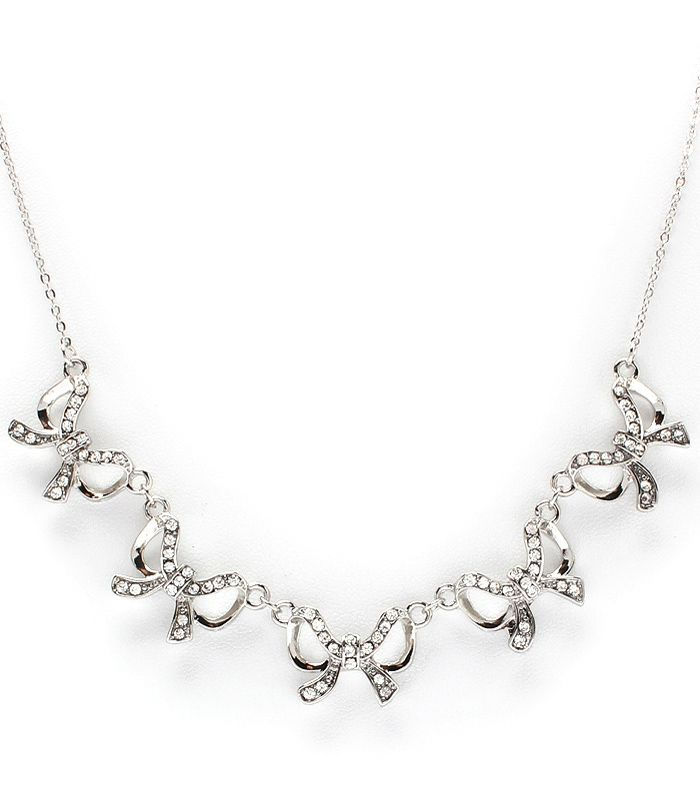 Beautiful necklace with five ribbons tied in bows adorned with crystal studs hanging on a link chain. The adorable necklace is a perfect...
