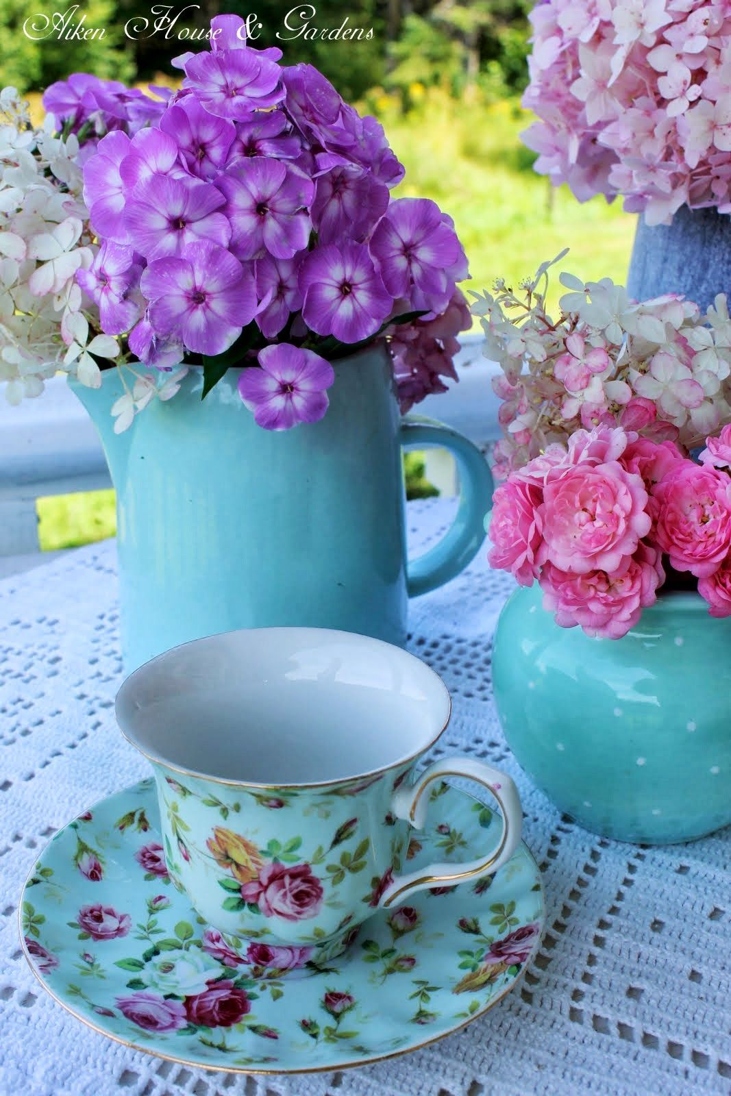Use purple flowers in white or clear pitchers