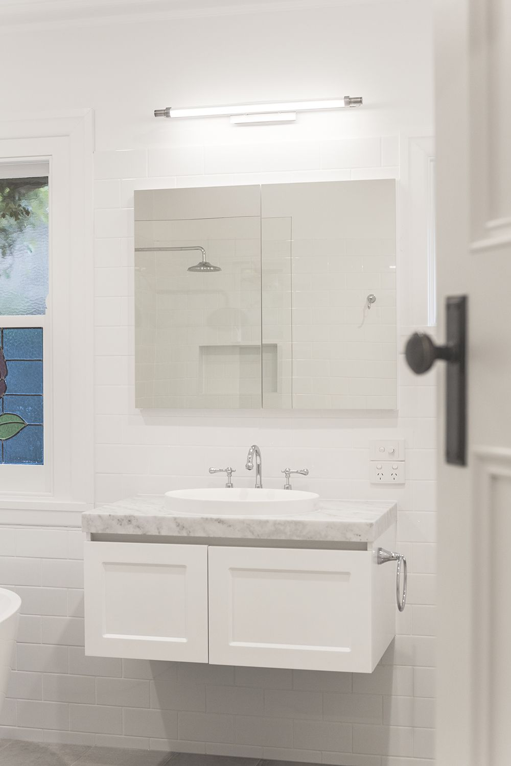 A Traditional white and grey heritage bathroom renovation in ...