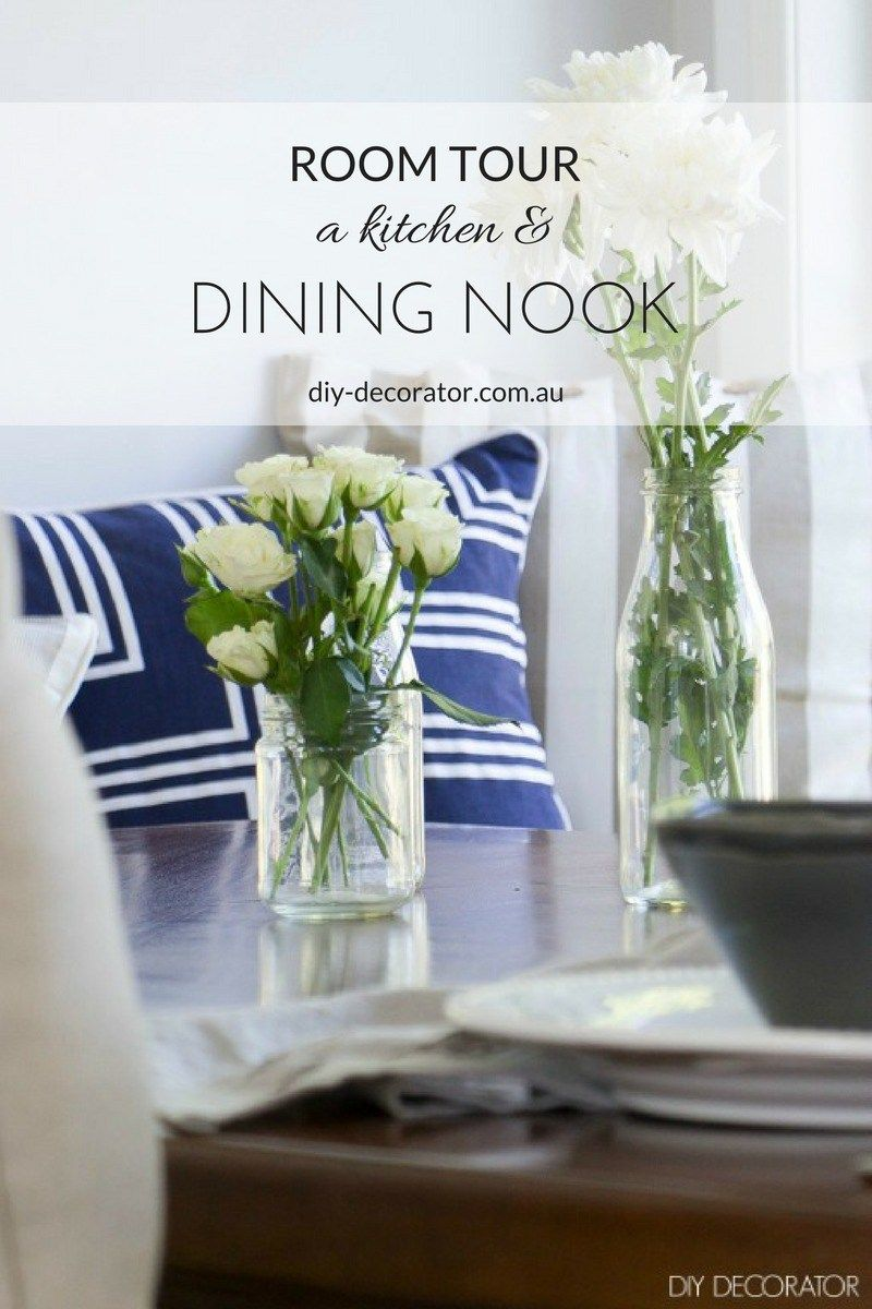 Room Tour: A Kitchen & Dining Nook - Built in banquette. Beautifully set table with white flowers.