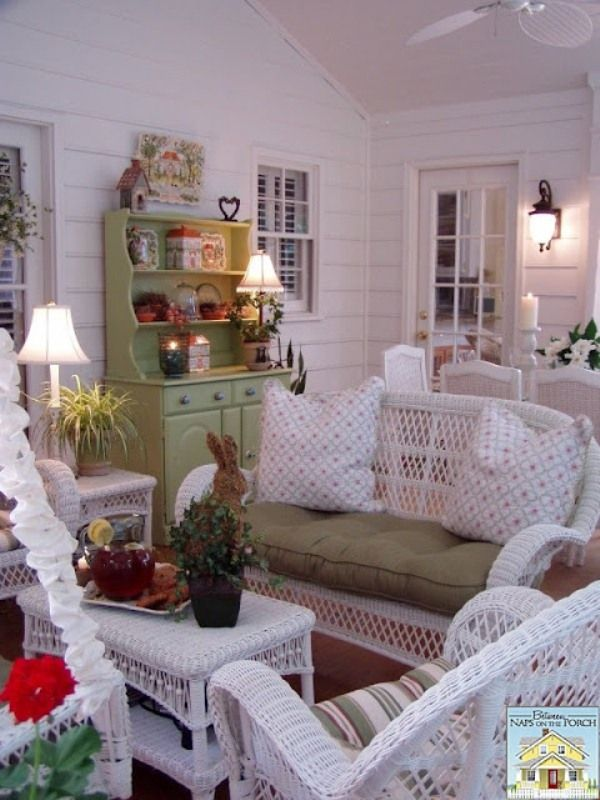 Screened-in Porch with White Wicker and Green Hutch. BetweenNapsOnThePorch.com #decor