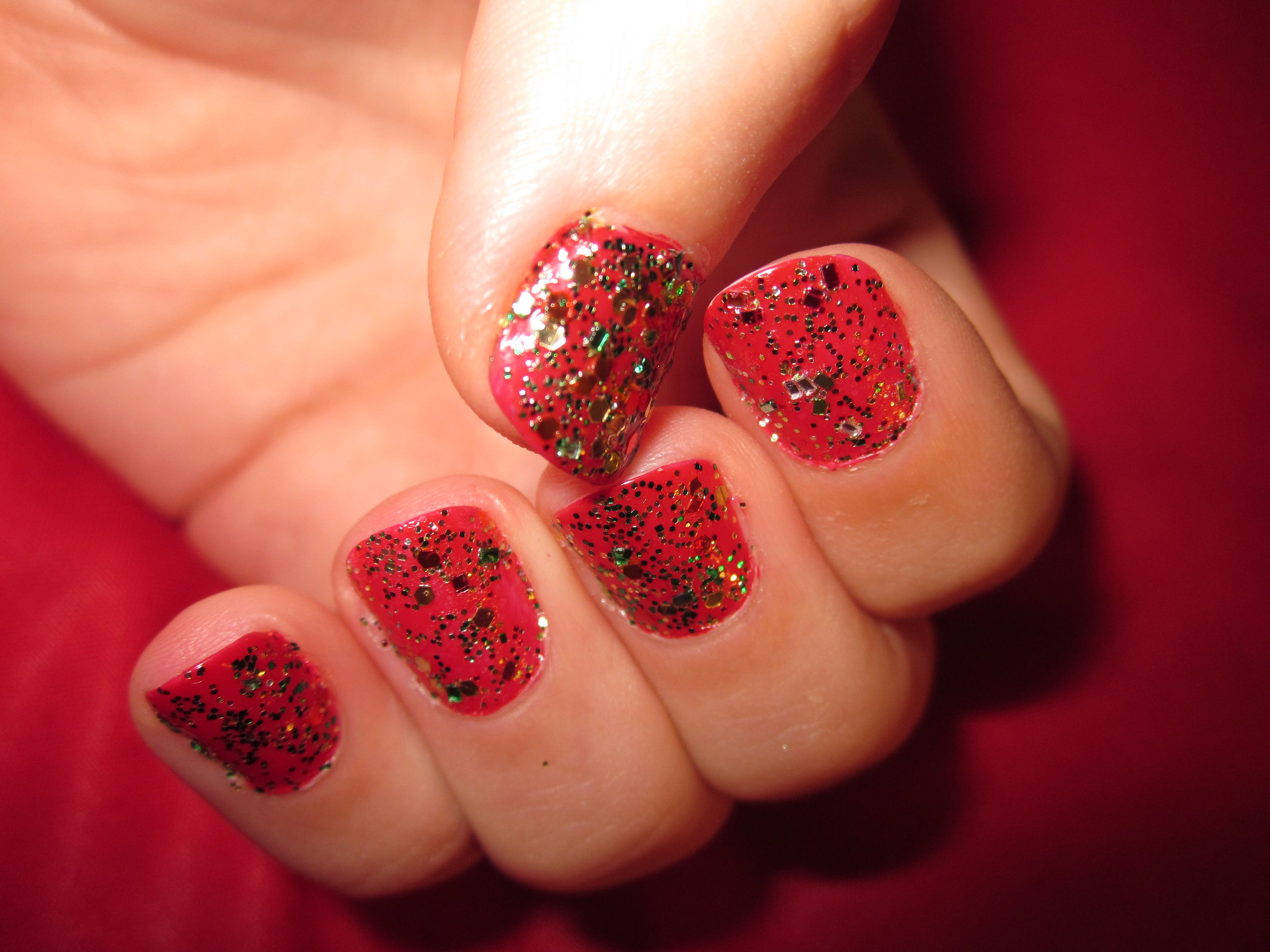 My Christmas Nails!   Sally Hansen Extreme Nails in Cherry Red, left over glitter in various sizes colors shapes and sizes from holiday projects and Sally Hansen Super Shiny Top Coat. Bring on the festivities!