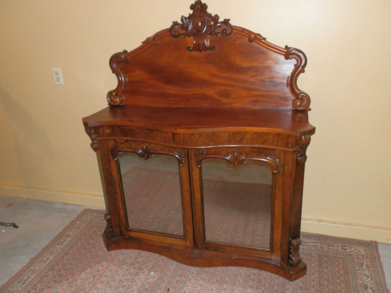 Antique victorian mirrored front carved credenza