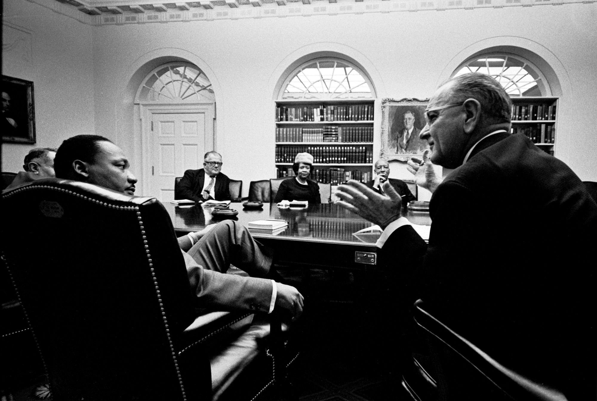 L-R Foreground: Martin Luther King, Jr., President Lyndon B. Johnson. Background: unidentified, Andy Biemiller, Dorothy Height, A. Philip Randolph