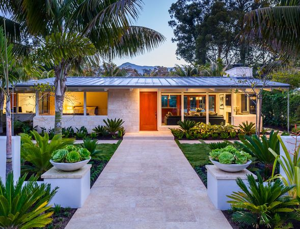 Gorgeous House With Metal Roof Large Porch And Tropical Landscaping Mid Century Modern Exterior Mid Century Exterior Mid Century Landscaping