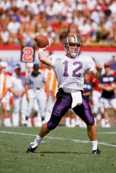 8ae752c5a Quarterback Billy Joe Hobert of the Washington Huskies goes for the pass  against the Stanford Cardinals at Stanford Stadium in September 7 1991 in.