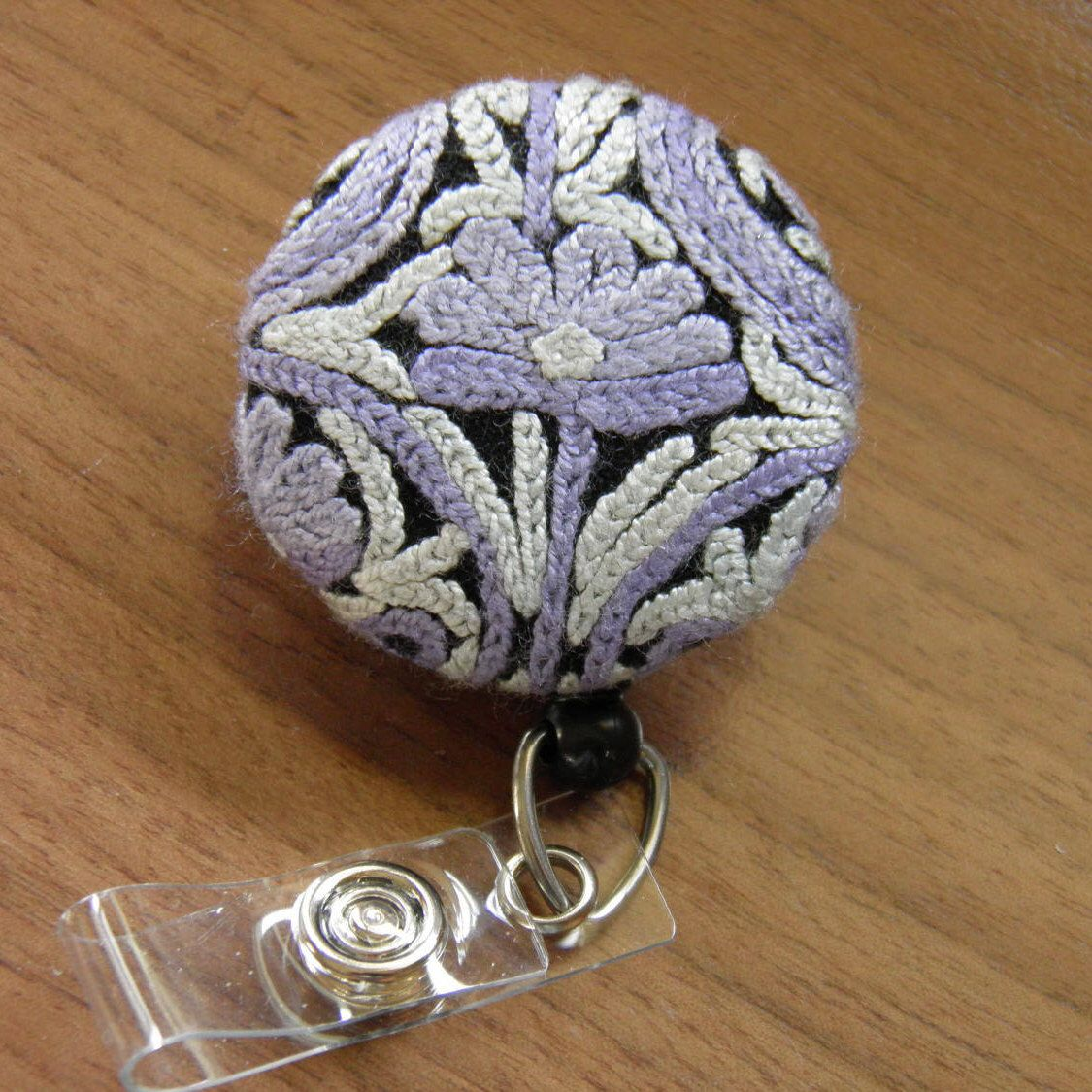 Embroidered Badge Reel , ID holder by ChangeYourBadge on Etsy https://www.etsy.com/listing/520593259/embroidered-badge-reel-id-holder