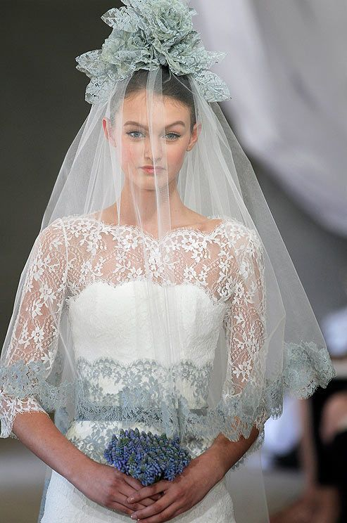 Carolina Herrera Bridal Spring 2013. There's something so lovely about the little blue lace touches.