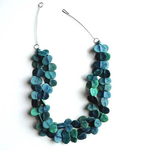 This multi strand necklace is my abstract take on seaweed. Two strands and 5 shades of blue green beads that were all hand formed and finished. The clasp is an easy to use hook made from sterling silver. Length is about 21 inches. Thank you! **For details on sales, new work and special projects subscribe to my newsletter at genevievewilliamson.com