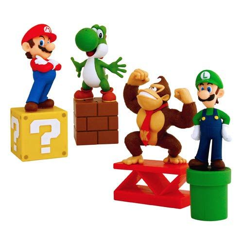 Super Mario Bros. Paperweight Set - Too bad I work in a slightly paperless environment. :/