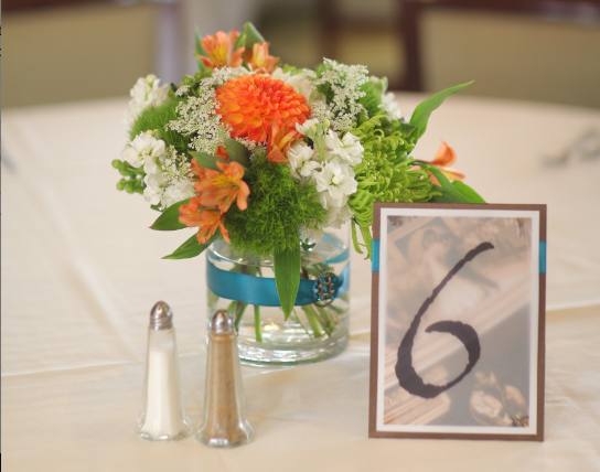 Table Number - engagement photos, pasted on card stock and covered with a vellum paper where the table number was printed on
