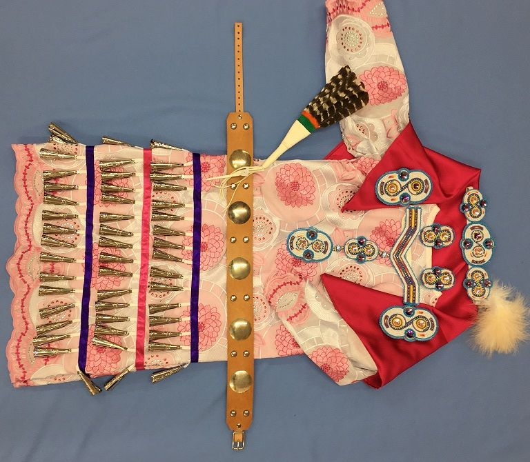Girls jingle dress available on our website at www.sharpsindianstore.com Also available on our website girls Concho belt, child's fan, girls fancy style beadwork set complete with headband, choker, hair ties, and earrings.