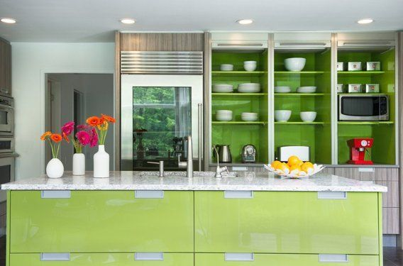 Lime green kitchen cabinets. Glass front fridge refrigerator. Contemporary bright kitchen