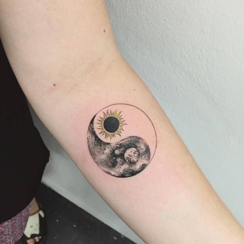 Sun,moon Yin Yang tattoo on the forearm. Tattoo artist Hongdam