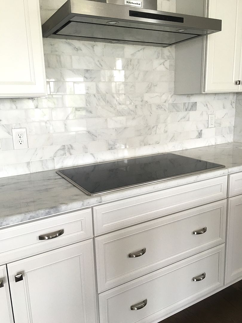 Carrera Marble Subway Tile Backsplash With White Cabinets