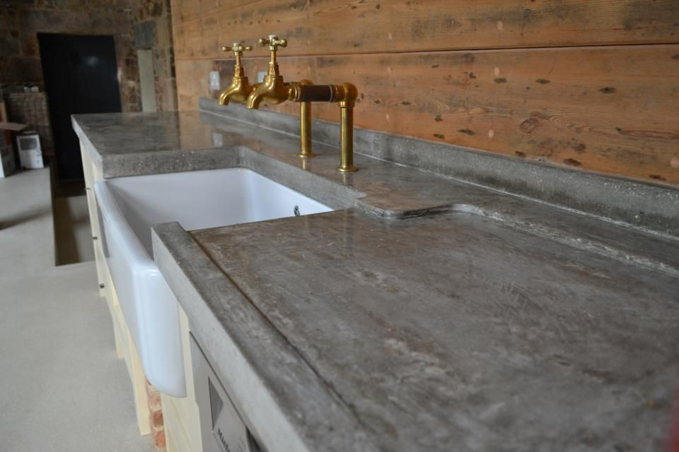 Hand Trowelled Polished Concrete Worktop With Sloped Drainer And Reclaimed Bib Taps Concrete Kitchen Polished Concrete Kitchen Outdoor Kitchen