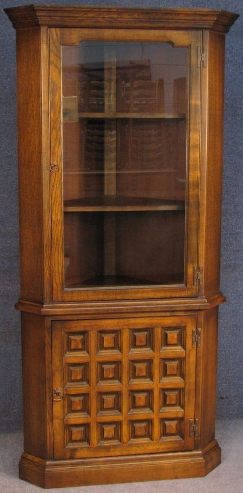 younger toledo spanish style chestnut u0026 ash tall corner cabinet on cupboard