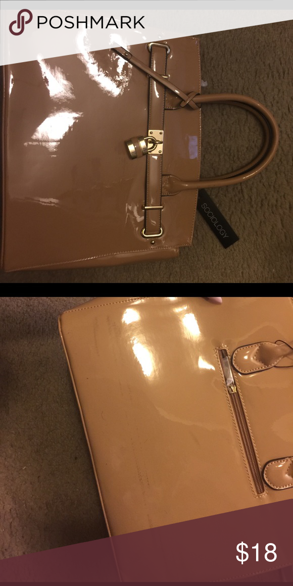 Satchel bag Brand new. Bag has some marks from rubbing against another bag in my closet. I'm not sure how to get it out. This item is a final sale. Do not buy it if you're going to return it. Please refer to the pictures. Bags Satchels