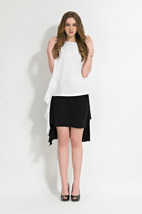 Show White Top With Black Bottom Both With Draped Detail You