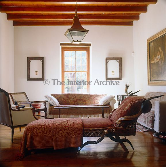 The Living Room Has Been Arranged With Minimal Clutter And Is Furnished With Antique Sofas And Armchairs Around A Central Co Interior Antique Sofa Coffee Table