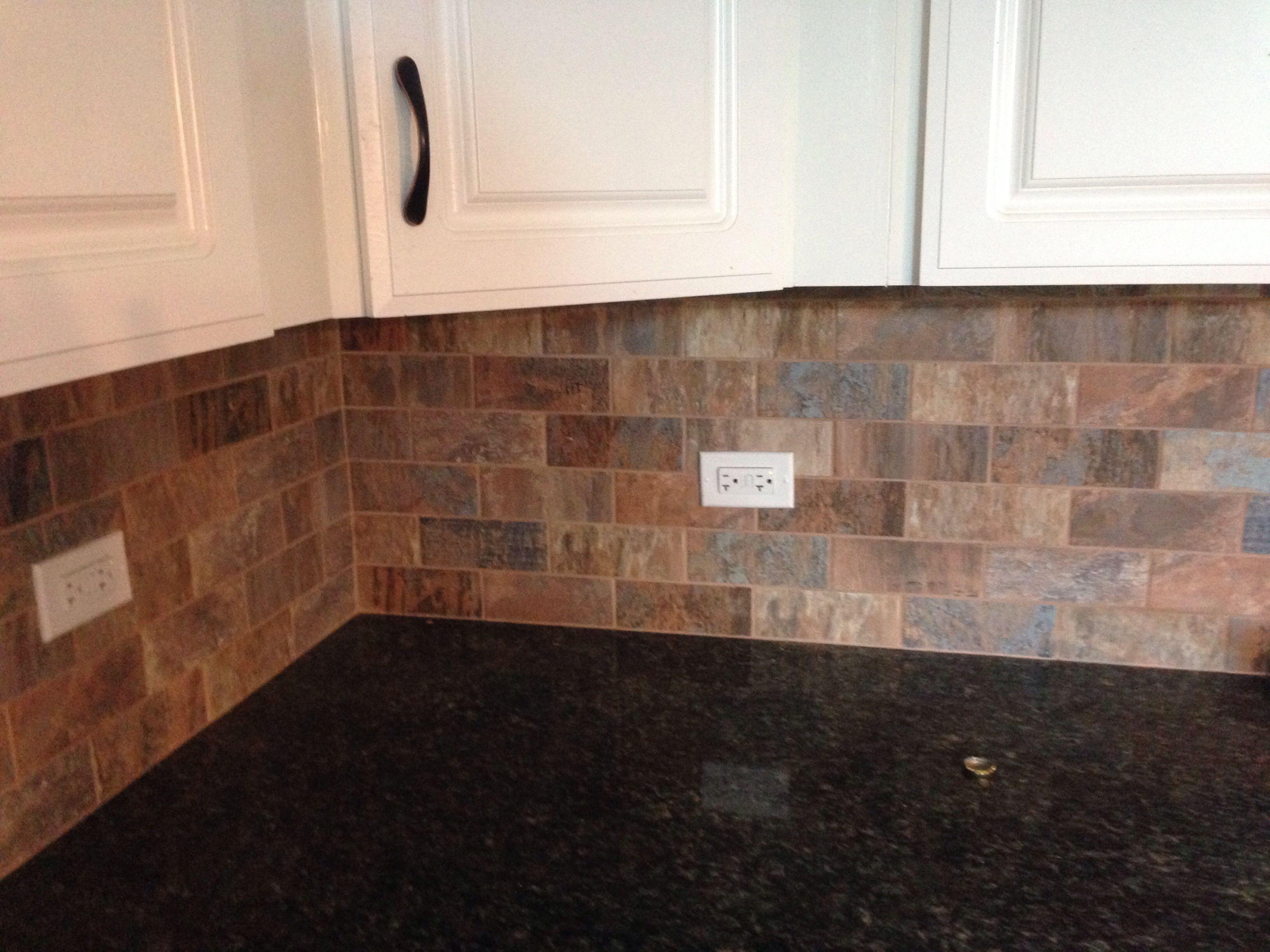 Backsplash made from 4 different 12 5 x 50cm porcelain floor tile patterns cut into brick shapes