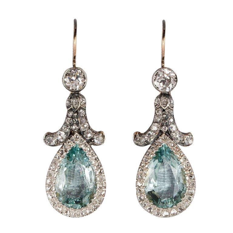 Edwardian diamond aquamarine platinum earrings. c. 1895-1905. Each earring features 1 pear-shaped aquamarine surrounded by bead-set rose-cut diamonds, the top consisting of old mine-cut, rose-cut and old European-cut diamonds. $13,500      Photography    Location  Sheila Goldfinger Antiques & Estate Jewelry