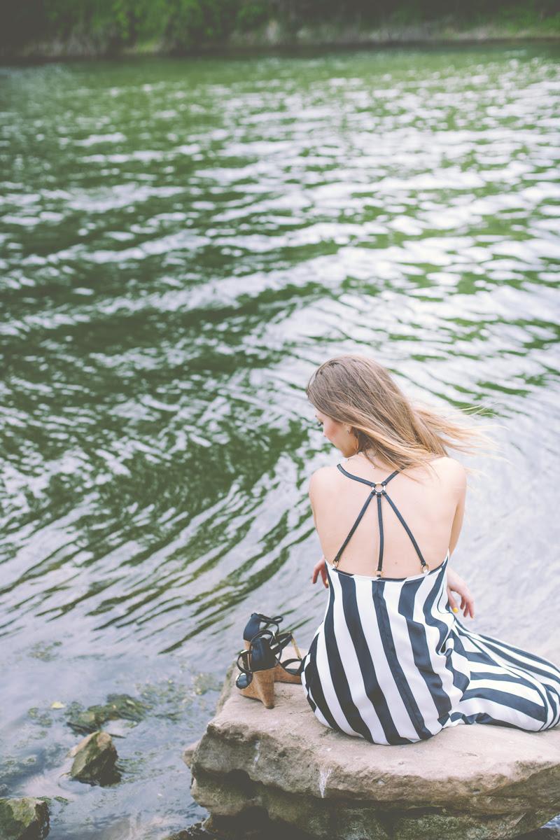 AshLee Frazier sitting by a lake.