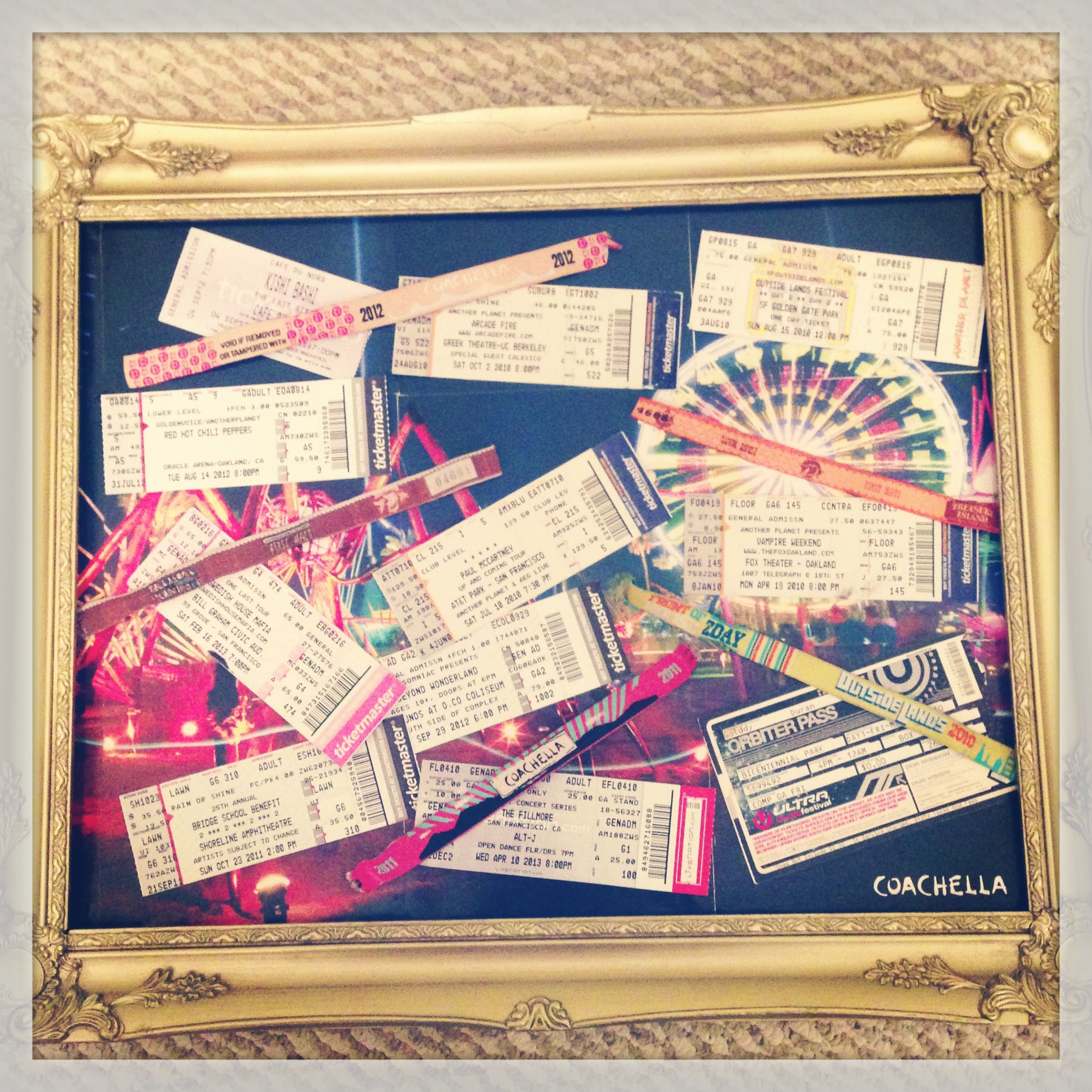 i made a magnet board with old concert ticket stubs and festival