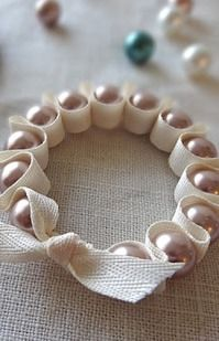 Make for a Christmas tree ornament!  Pearl And Twine Bracelet