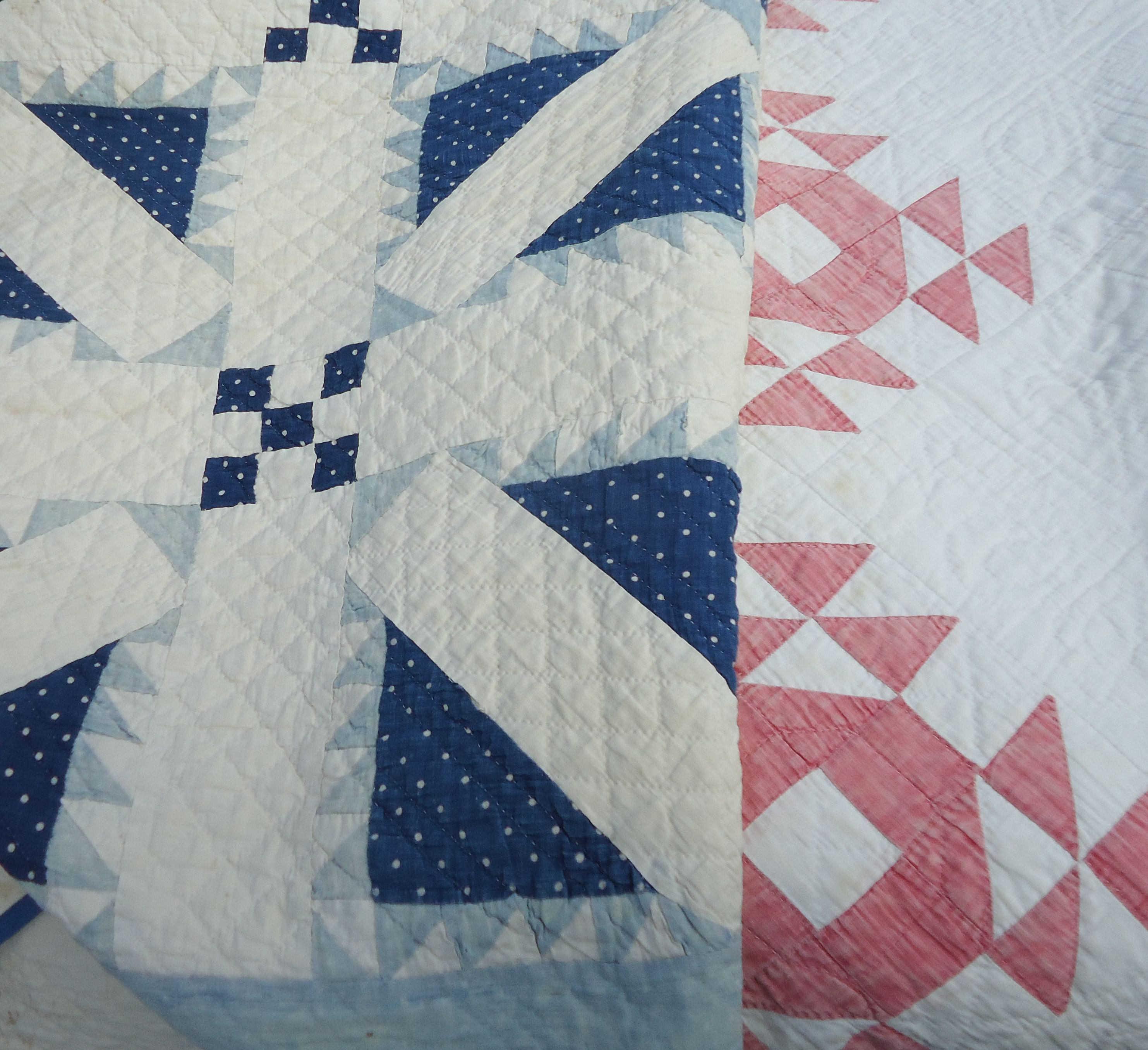 Vintage quilts at Brimfield.